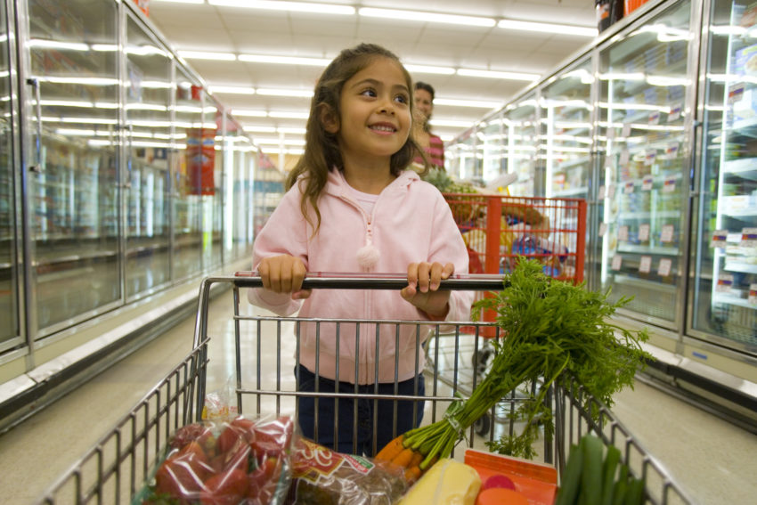 Latina girl grocery cart healthy food carrots obesity