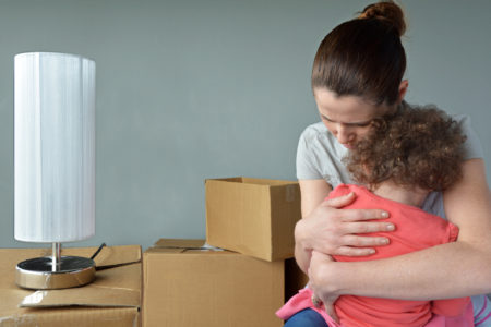 Sad evicted mother with child worried relocating house