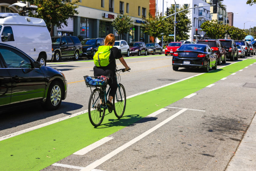 Cyclist riding the green bicycle lane