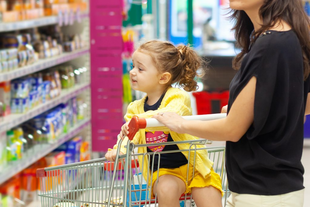 child and mom grocery store food sugary drink shopping